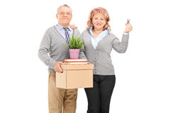 Mature couple holding moving boxes and keys Stock Photos