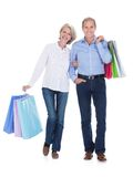 Mature couple holding shopping bags Royalty Free Stock Photo