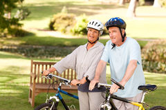 Mature couple holding their bikes Royalty Free Stock Photography