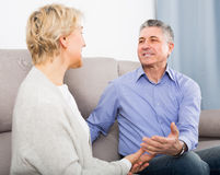 Mature couple in house are warmly reconciled after quarrel Royalty Free Stock Photo