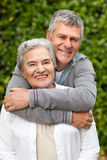 Mature couple hugging in the garden Royalty Free Stock Photography