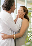 Mature couple hugging at home. Stock Image