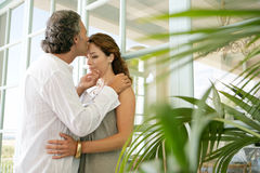 Mature couple hugging at home. Stock Images