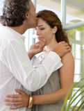 Mature couple hugging at home. Stock Photo