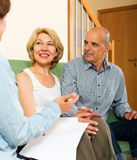 Mature couple with insurance agent Stock Photo