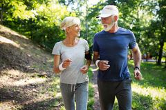 Mature couple jogging and running outdoors in city. Senior couple jogging and running outdoors in nature stock photography