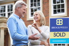 Mature Couple With Keys To New Home Royalty Free Stock Photo