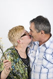 Mature couple kiss Stock Images