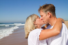 Mature couple kissing royalty free stock photos