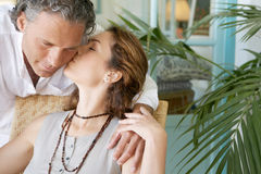 Mature couple kissing. Royalty Free Stock Photo