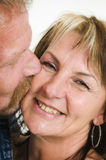 Mature couple kissing Royalty Free Stock Photography