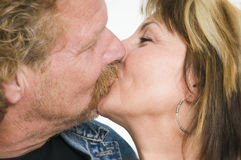 Mature couple kissing Royalty Free Stock Photo