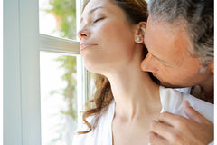 Mature Couple kissing by garden doors. Stock Photography