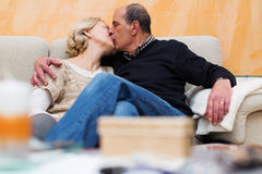 Mature couple kissing in home Royalty Free Stock Photos