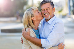 Mature Couple Kissing. Loving Senior Couple Outdoors Kissing Royalty Free Stock Image