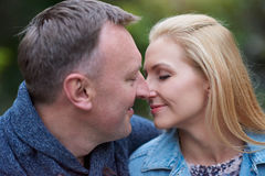 Mature couple kissing outside Stock Images