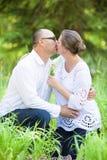 Mature couple kissing stock image