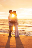 Mature Couple Kissing at Sunset Royalty Free Stock Images