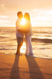 Mature Couple Kissing at Sunset Royalty Free Stock Photos