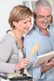 Mature couple in kitchen Royalty Free Stock Photo