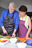 Mature couple in kitchen Royalty Free Stock Photos