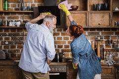 Mature couple in kitchen Royalty Free Stock Image