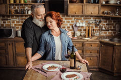 Mature couple in kitchen royalty free stock photography