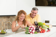 Mature couple in the kitchen Royalty Free Stock Images