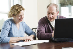 Mature couple at laptop Stock Images