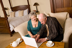Mature couple with laptop Stock Images