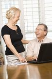 Mature couple with laptop. stock image