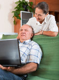 Mature couple  with laptop Stock Photo