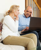 Mature couple  with laptop Royalty Free Stock Image
