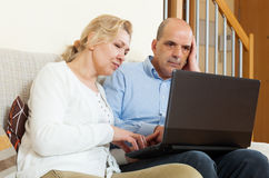 Mature couple  with laptop Royalty Free Stock Images