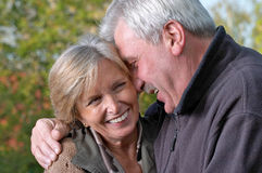 Mature couple laughing Stock Images