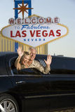 Mature Couple In Limousine Waving Hands Stock Photography
