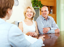 Mature couple listening female manager Stock Photography