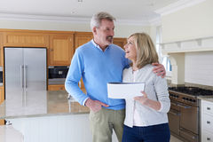 Mature Couple Looking Around Kitchen Of House For Sale stock photos