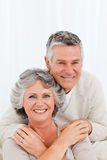 Mature couple looking at the camera Stock Images