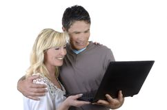 Mature couple looking at notebook Royalty Free Stock Photos