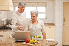 Mature couple looking at their laptop Stock Photo