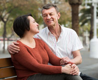 Mature couple in love posing outdoors together Royalty Free Stock Images