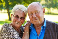 Mature couple in love senior portraits. Mature couple in love senior citizens. Portraits of a married couple royalty free stock photo