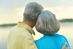 Mature couple in love at sunset stock photos