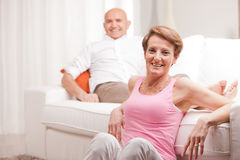 Mature couple loving each other at home Stock Photos