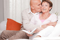 Mature couple loving each other at home Royalty Free Stock Photos