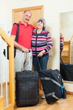 Mature couple with luggage going on holiday. Mature couple with luggage in home going on holiday Stock Photos