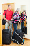 Mature  couple with luggage Stock Photos