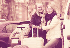 Mature couple with luggage at street Stock Photo