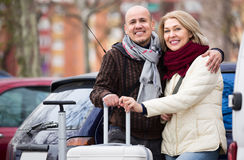 Mature couple with luggage at street Royalty Free Stock Photos